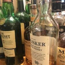 The well stocked bar in the Mackintosh Lounge
